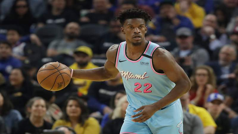 Miami Heat forward Jimmy Butler dribbles upcourt against the Golden State Warriors during the first half, Feb. 10, 2020, in San Francisco.