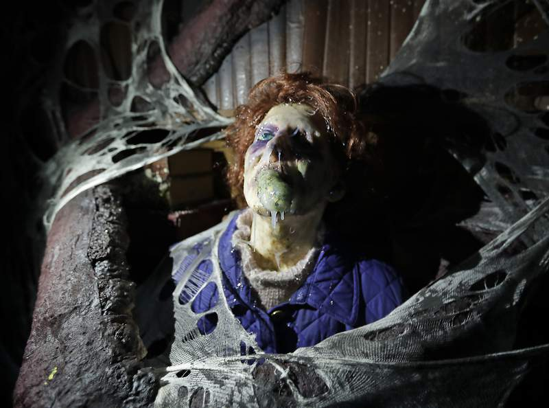 """FILE - In this Sept. 12, 2018 file photo, the character Barb appears in grand, gory style in the Stranger Things haunted house during Halloween Horror nights at Universal Studios in Orlando, Fla. After a pandemic-related absence of a year, Halloween Horror Nights are back with haunted houses based on the Texas Chainsaw Massacre and The Bride of Frankenstein"""" planned for Universal theme parks in California and Florida, the company announced Thursday, July 15, 2021. (AP Photo/John Raoux, File)"""