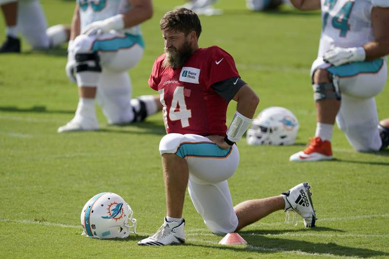 Ryan Fitzpatrick of the Miami Dolphins stretches before starting drills during training camp at Baptist Health Training Facility at Nova Southern University on August 22, 2020 in Davie, Florida.