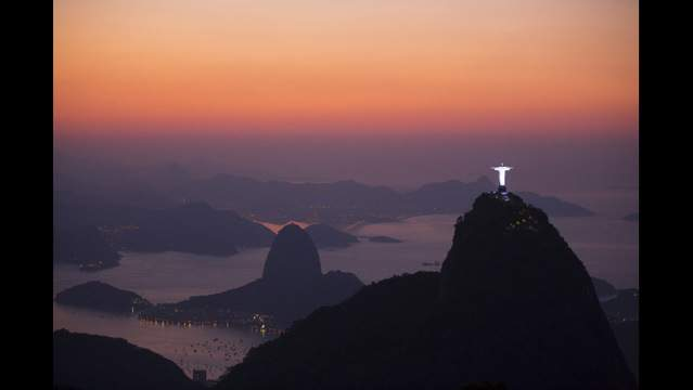 This Sept. 6, 2012 photo shows the Christ the Redeemer statue, located on the top of Corcovado Mountain and the Sugar Loaf Mountain, are seen from the Parque Nacional da Tijuca, or Tijuca national park in Rio de Janeiro, Brazil. This nearly...
