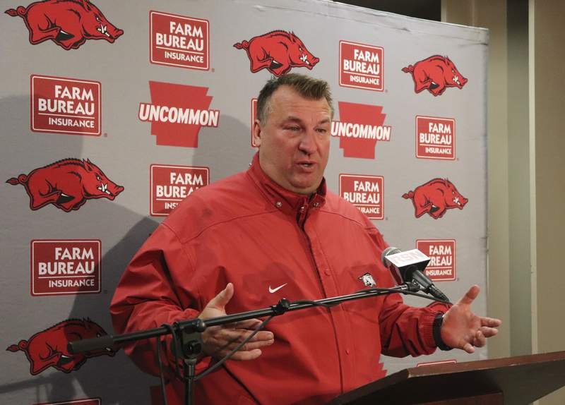 FILE - In this Nov 24, 2017 file photo, Bret Bielema speaks with reporters beneath Razorback Stadium in Fayetteville, Ark. Bielema is returning to the Big Ten and his home state to coach Illinois. Illinois hired the former Wisconsin and Arkansas coach, hoping he can turn around a program with nine straight losing seasons. (AP Photo/Kelly P. Kissel)