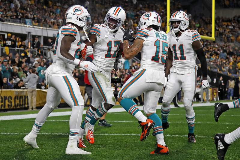 Miami Dolphins wide receiver Allen Hurns (17) celebrates his touchdown during the first half of an NFL football game against the Pittsburgh Steelers in Pittsburgh, Monday, Oct. 28, 2019. (AP Photo/Don Wright)