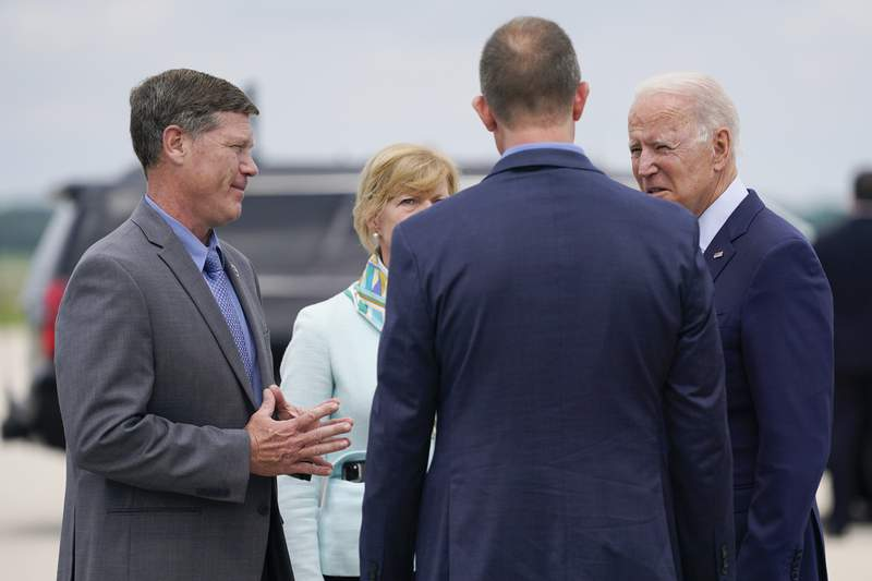 FILE - In this June. 29, 2021 file photo, President Joe Biden talks with Rep. Ron Kind, D-Wis., left, Sen. Tammy Baldwin, D-Wis., and La Crosse Mayor Mitch Reynolds as he arrives on Air Force One at La Crosse Regional Airport, in La Crosse, Wis. Kind, who served more than 24 years in a southwestern Wisconsin district that former President Donald Trump carried in 2020, announced Tuesday, Aug. 10, 2021, that he won't seek reelection in 2022. (AP Photo/Evan Vucci File)
