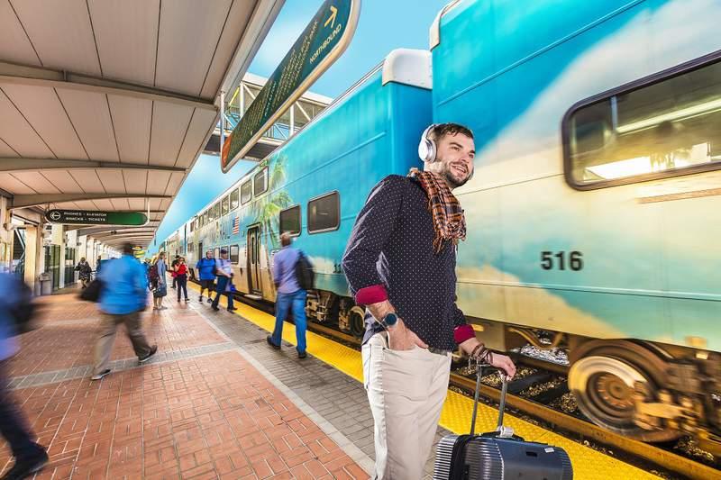 A man waits at the Tri Rail.