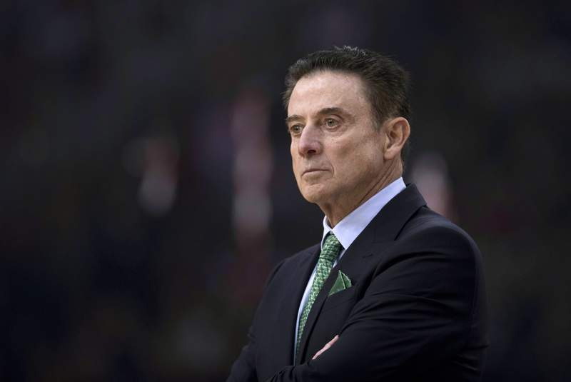 FILE - In this Jan. 4, 2019, file photo Panathinaikos coach Rick Pitino looks on during a Euroleague basketball match between Panathinaikos and Olympiakos in Piraeus near Athens. The coronavirus was already in town by the time Pitino arrived. It never fully let go of its grip around Iona. Forced to pause four times this season because of the virus, once for nearly two months, the Gaels need to win their conference tournament this week to make the NCAA Tournament.  (AP Photo/Petros Giannakouris, File)