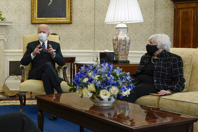 President Joe Biden, accompanied by Vice President Kamala Harris and Treasury Secretary Janet Yellen, meets with business leaders to discuss a coronavirus relief package in the Oval Office of the White House, Tuesday, Feb. 9, 2021, in Washington. (AP Photo/Patrick Semansky)