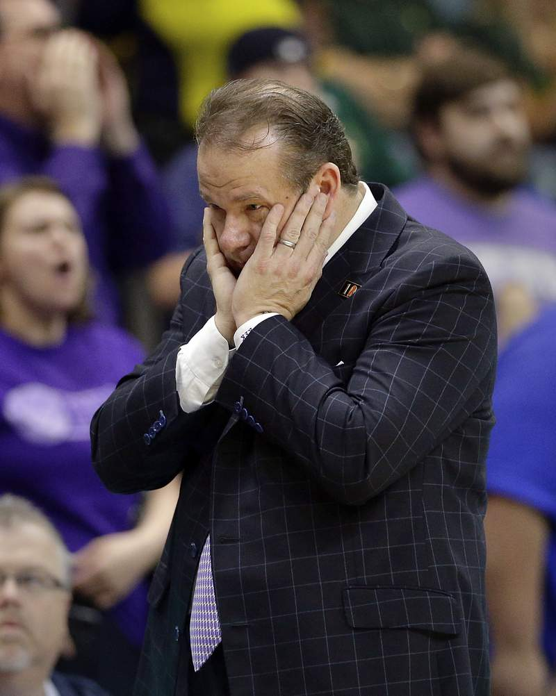 FILE - In this March 10, 2018, file photo, Stephen F. Austin head coach Kyle Keller reacts during the second half of an NCAA college basketball game against Southeastern Louisiana in the Southland Conference's men's basketball tournament championship game in Houston. Stephen F. Austin had three teams on a list released Tuesday that could have faced bans because they posted a four-year score below 930. Stephen F. Austin avoided postseason bans because of low scores on the NCAA's Academic Progress Rate on Wednesday, May 20, 2020, by agreeing to several sanctions including probation, scholarship reductions and the forfeiture of wins. Stephen F. Austin's men's basketball team had the lowest score of any team in Division I. (AP Photo/Michael Wyke, File)