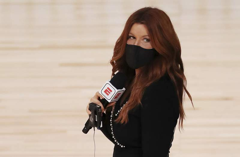 FILE - In this Friday, July 31, 2020, file photo, ESPN reporter Rachel Nichols stands on the court before an NBA basketball game between the Houston Rockets and the Dallas Mavericks, in Lake Buena Vista, Fla. In a decision announced Tuesday, July 6, 2021, ESPN has replaced Nichols as its sideline reporter for the NBA Finals following a report detailing critical comments she made about Black colleague Maria Taylor. (Mike Ehrmann/Pool Photo via AP, File)