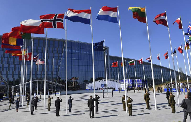 FILE - In this May 25, 2017 file photo, flags of NATO member countries flutter during a NATO summit in Brussels. The NATO military alliance and the European Union on Tuesday, Aug. 3, 2021 joined a growing chorus of international condemnation of Iran's alleged attack on a merchant ship in the Arabian Sea last week and urged Tehran to respect its international obligations. (AP Photo/Geert Vanden Wijngaert, Pool, File)