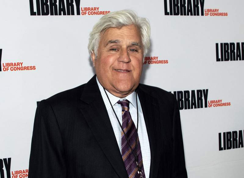 FILE - Jay Leno attends the Gershwin Prize Honoree's Tribute Concert in Washington on March 4, 2020. Leno is host of You Bet Your Life, a reboot of the Groucho Marx game show that debuts Monday on Fox TV stations. (Photo by Brent N. Clarke/Invision/AP, File)