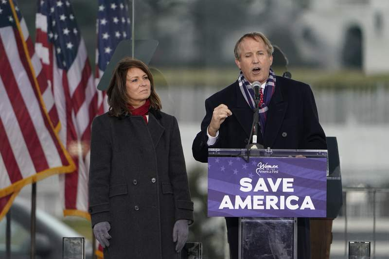 FILE - This Jan. 6, 2021, file photo, Texas Attorney General Ken Paxton speaks in Washington, at a rally in support of President Donald Trump. Paxton, who is under FBI investigation over claims of using his office to help a political donor, gave a job in recent months to another supporter, a onetime neighbor whose family chipped in $50,000 to help the Republican fight a 2015 felony indictment. (AP Photo/Jacquelyn Martin, File)