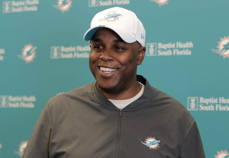 FILE - In this April 17, 2019, file photo, Miami Dolphins general manager Chris Grier speaks during a news conference during voluntary minicamp at the Dolphins NFL football training facility in Davie, Fla. The Dolphins havent used their top pick on a quarterback since 2012, when they drafted Ryan Tannehill. (AP Photo/Lynne Sladky, File)