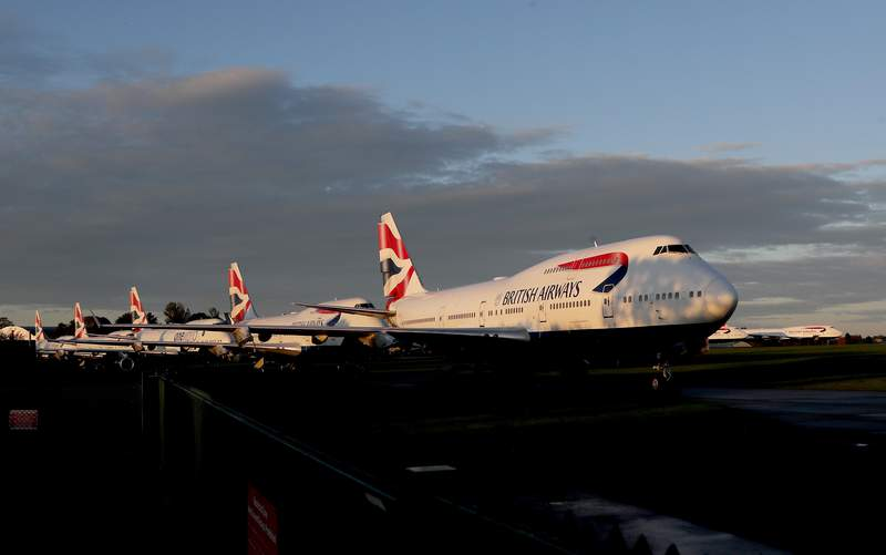 Retired British Airways Boeing 747-400 parked at Cotsworld Airport in Kemble, England, Sunday, Oct. 11, 2020. The retirement of the Jumbo Jet fleet was brought forward as a result of the impact the COVID-19 pandemic had on the airline and the aviation sector. (AP Photo/Frank Augstein)