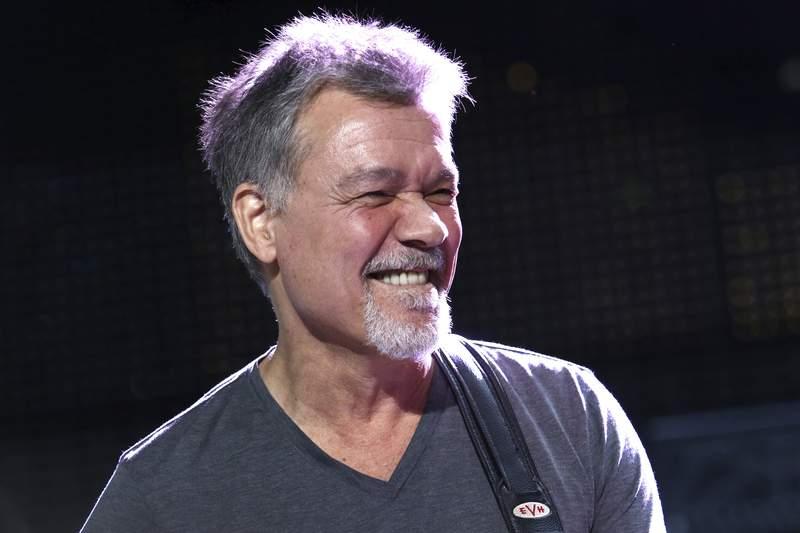 Eddie Van Halen performs on Aug. 13, 2015, in Wantagh, N.Y. Van Halen, who had battled cancer, died Tuesday. He was 65.