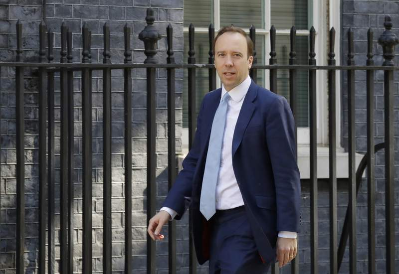 FILE - In this file photo dated Wednesday, May 20, 2020, Britain's Health Secretary Matt Hancock arrives at Downing Street in London. The British government is scrapping Public Health England agency that has taken blame for the countrys uneven response to the coronavirus, Health Secretary Matt Hancock said Tuesday Aug. 18, 2020, the work of will become part of a new body, to be called National Institute for Health Protection. (AP Photo/Kirsty Wigglesworth, FILE)