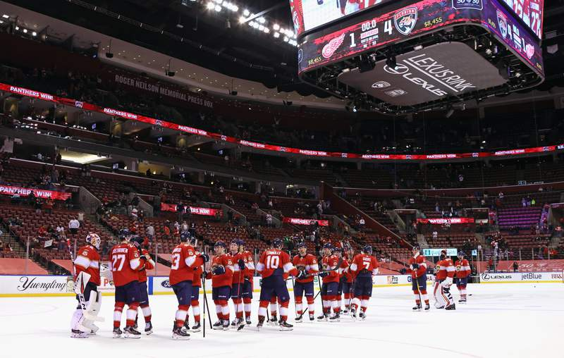 The Florida Panthers celebrate their 4-1 win over the Detroit Red Wings at the BB&T Center on March 30, 2021 in Sunrise, Florida.