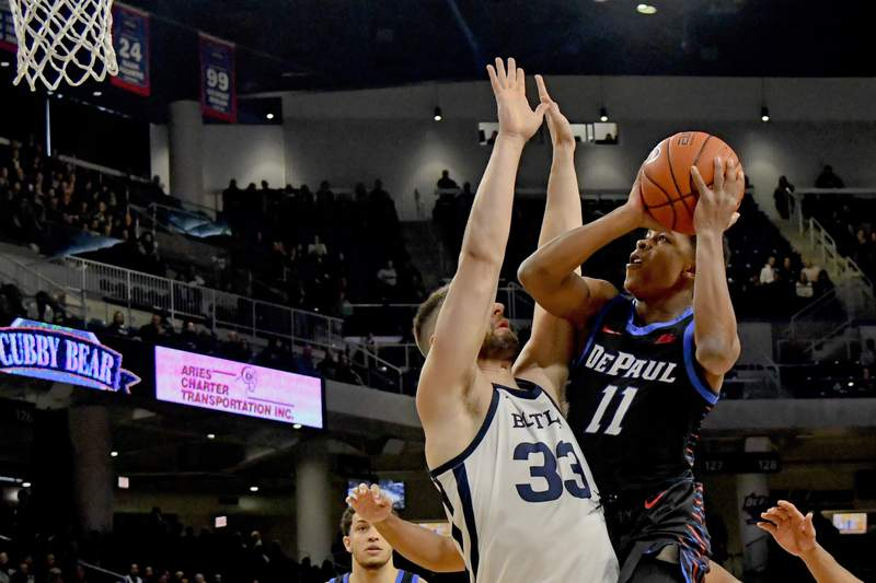 Charlie Moore shoots over Butler's  Bryce Golden during the first half of a game Jan. 18, 2020 in Chicago.