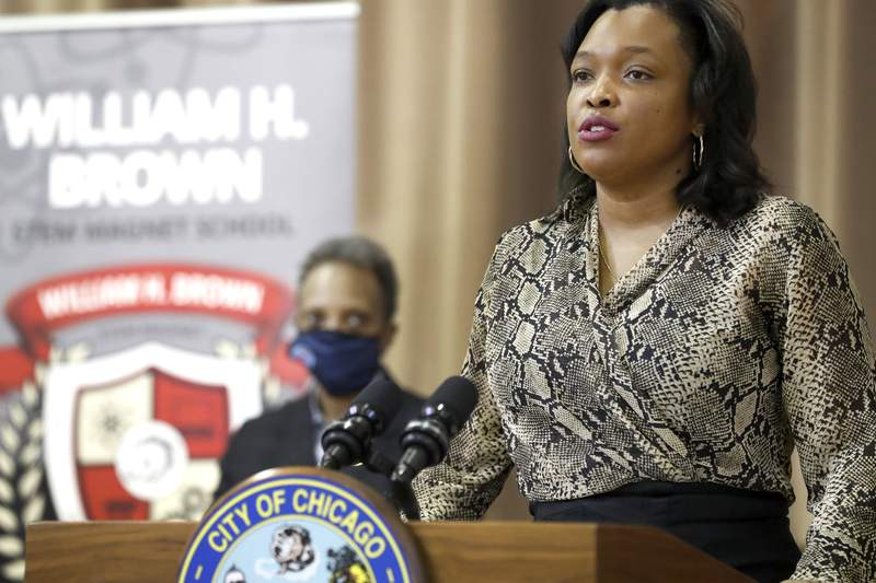 """FILE - In this Feb. 11, 2021 file photo, Chicago Public Schools CEO Janice K. Jackson, right, speaks during a news conference as Chicago Mayor Lori E. Lightfoot listens. The leader of Chicago Public Schools is leaving the post later this year saying it was time for """"the next chapter."""" Jackson, took the job in 2018 after serving in the position temporarily. She said Monday, May 3, 2021 that she will not renew her contract when it expires June 30. (AP Photo/Shafkat Anowar, Pool File)"""