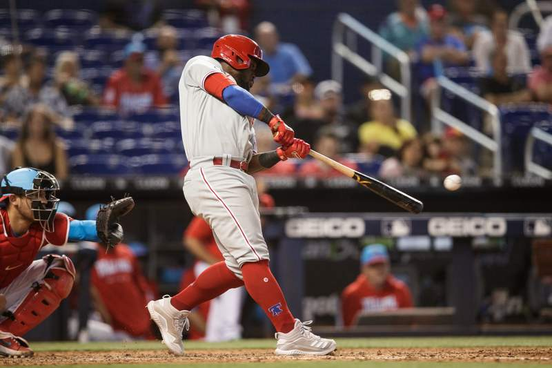 Odúbel Herrera of the Philadelphia Phillies hits a single and bats in a run in the tenth inning against the Miami Marlins at loanDepot park on September 5, 2021 in Miami, Florida.