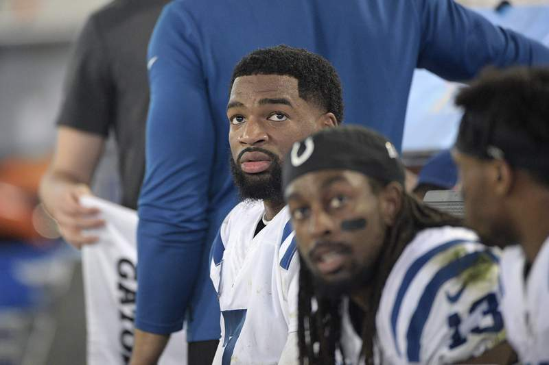 FILE - Indianapolis Colts quarterback Jacoby Brissett (7) and wide receiver T.Y. Hilton (13) watch from the bench during the second half of an NFL football game against the Jacksonville Jaguars in Jacksonville, Fla., in this Sunday, Dec. 29, 2019, file photo.By joining the Dolphins, Brissett embraced a No. 2 role behind Tua Tagovailoa, who is being groomed as a potential franchise quarterback  unless Houston's Deshaun Watson goes on the trade block, and Miami pursues him.  Either way, Brissett will likely be on the bench at age 28. (AP Photo/Phelan M. Ebenhack, File)