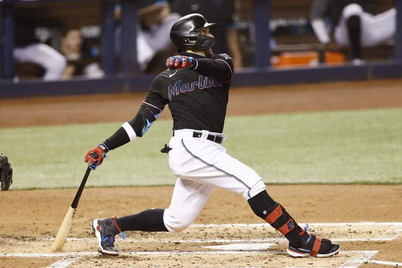 Isan Diaz of the Miami Marlins hits a grand slam during the third inning against the Milwaukee Brewers at loanDepot park on May 07, 2021 in Miami, Florida.