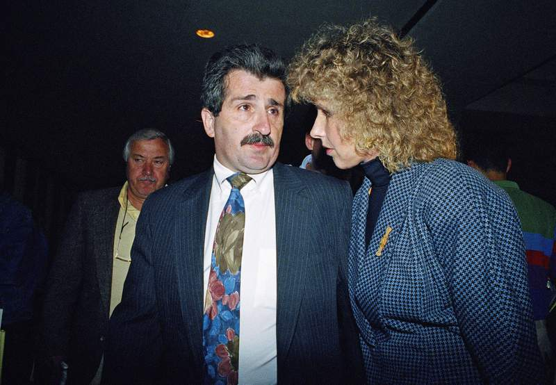 """FILE  In this May 27, 1992 file photo, Paul Solomon, center, talks with an unidentified friend as he leaves Westchester County Courthouse in White Plains, N.Y., after a jury found his former lover Carolyn Warmus, guilty of killing his wife in January of 1989. Prosecutors in New York have consented to DNA testing of evidence from the 1992 trial of so-called """"Fatal Attraction"""" killer Warmus, who was paroled two years ago after serving 27 years in prison for the murder of Solomon's wife. (AP Photo/Andrew Savulich, File)"""