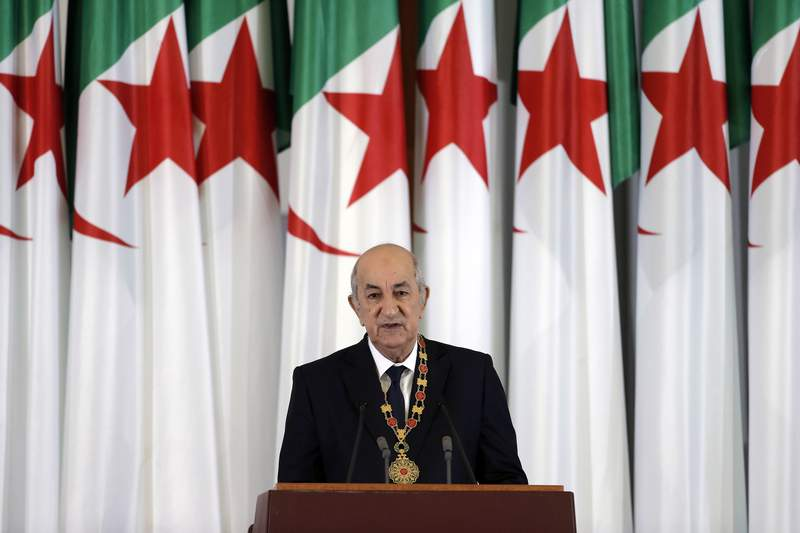 FILE - In this Thursday, Dec. 19, 2019 file photo, Algerian president Abdelmadjid Tebboune delivers a speech during an inauguration ceremony in the presidential palace, in Algiers, Algeria. Algerian President Abdelmadjid Tebboune marks a year in office Saturday but he is nowhere in sight since his evacuation to Germany more than six weeks ago for treatment of COVID-19. (AP Photo/Toufik Doudou, FILE)