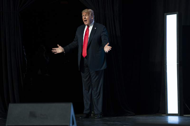 President Donald Trump arrives to speak to a group of young Republicans at Dream City Church, Tuesday, June 23, 2020, in Phoenix. (AP Photo/Evan Vucci)