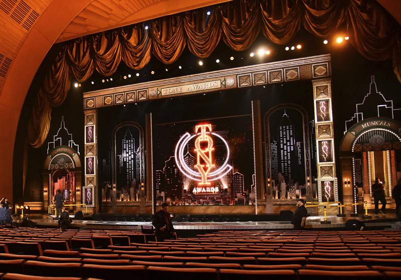 FILE - Workers prepare for the 73rd annual Tony Awards in New York on June 9, 2019. Producers of the telecast announced Wednesday that the Tonys will be held Sept. 26 and will air on CBS as well as Paramount+. (Photo by Charles Sykes/Invision/AP, File)