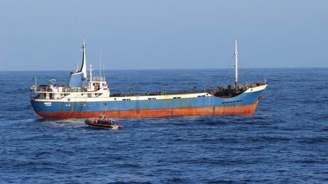 The U.S. Coast Guard tows the 150-foot fishing vessel Grace Zanzibar to the Dominican Republic, Sunday, July 23, 2017.
