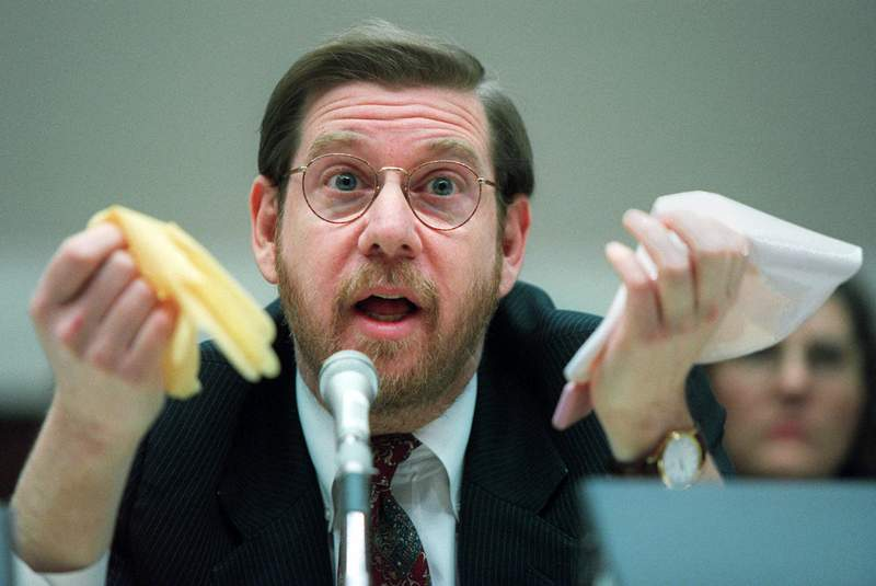 FILE - This Nov. 15, 1995 file photo shows then Food and Drug Administration (FDA) Administrator David Kessler testifying on Capitol Hill in Washington.  President-elect Joe Biden has picked Kessler to lead vaccine science in his drive to put 100 million shots into the arms of Americans in his administration's first 100 days and stem the COVID-19 pandemic. (AP Photo/Denis Paquin)