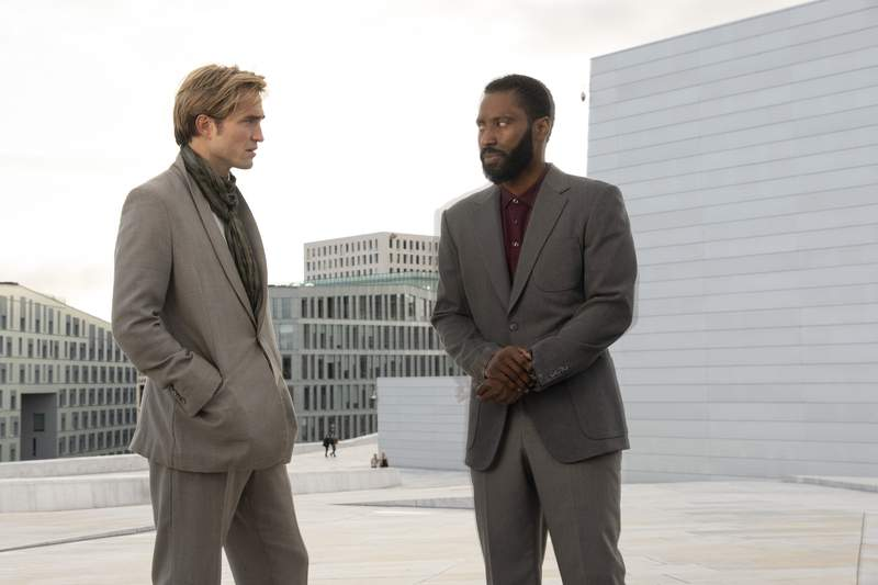 """This image released by Warner Bros. Entertainment shows Robert Pattinson, left, and John David Washington in a scene from """"Tenet.""""  (Melinda Sue Gordon/Warner Bros. Entertainment via AP)"""