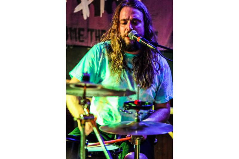 """In a photo provided by Russ Boxer, Kevin Clark plays drums as Jess Bess & The Intentions performs at a bar in Highwood, Ill., May 22, 2021. Clark, who played drummer Freddy """"Spazzy McGee"""" Jones in the 2003 movie """"School of Rock"""" with Jack Black, was killed when he was struck by a car while riding his bicycle along a Chicago street early Wednesday, May 26. (Russ Boxer via AP)"""