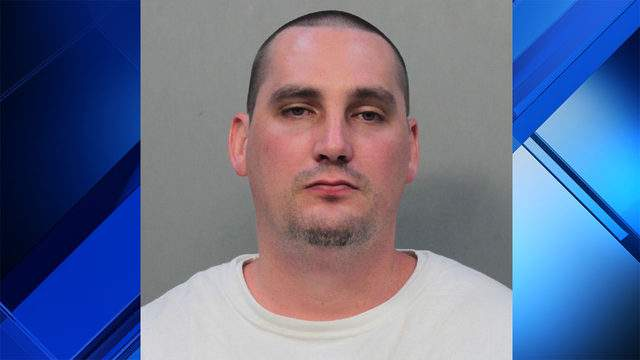 John Bridier, 31, is accused of punching a student in the eye at Barry University.