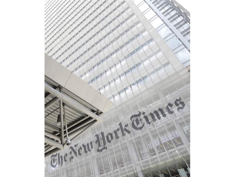 FILE - This June 22, 2019 file photo shows the exterior of the New York Times building in New York. The New York Times says it was wrong to trust the story of a Canadian man whose claims of witnessing and participating in atrocities as a member of the Islamic State was a central part of its award-winning 2018 podcast Caliphate. The 12-part series won a Peabody Award and was a Pulitzer Prize finalist. But it began to unravel when Canadian authorities in September arrested Shehroze Chaudhry on charges of perpetrating a terrorist hoax. He was included in the podcast under the alias Abu Huzayfah. The Times said its journalists should have done a better job vetting him, and not included his story as part of the podcast. (AP Photo/Julio Cortez, File)