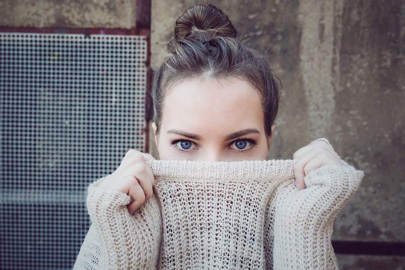 Woman in a sweater.