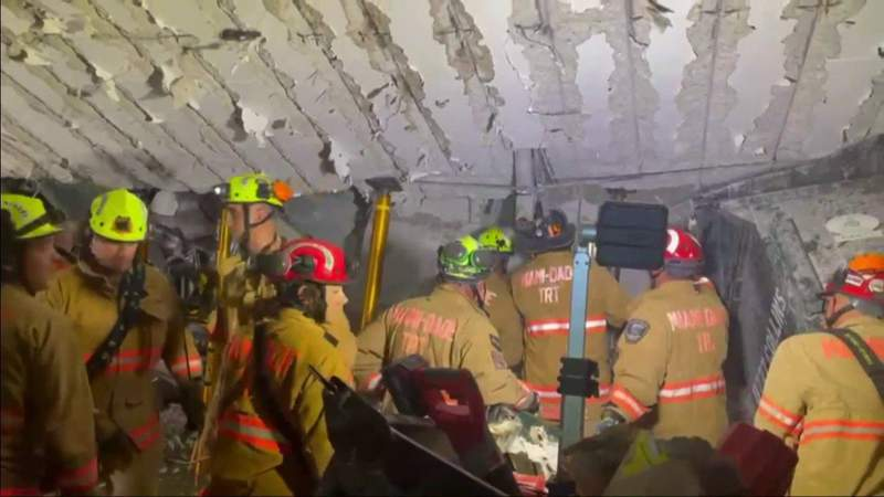 Engineers help search-and-rescue teams move under collapsed building