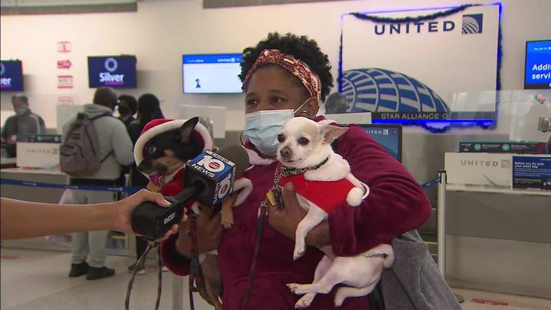 Holiday travelers say they want to see family despite virus warnings