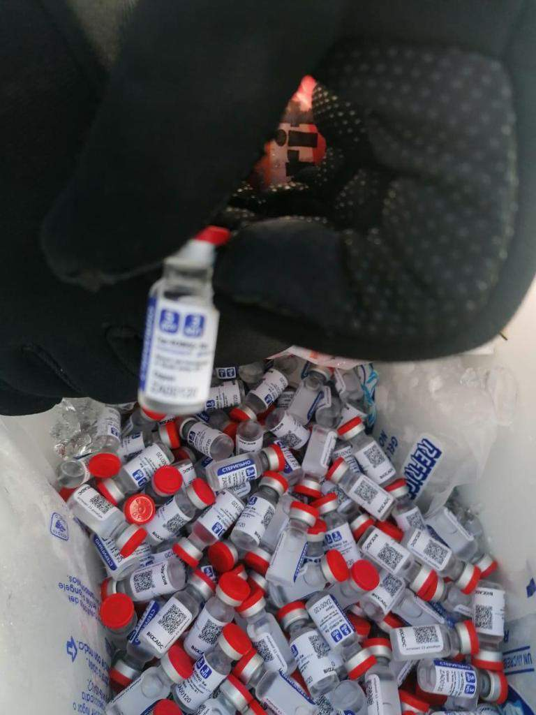 In this photo released by Mexico's tax agency, SAT, on March 17, 2021, officials show vials of seized, alleged Sputnik V vaccines for COVID-19 in Campeche, Mexico. RDIF, the Russian entity that paid for the vaccine's development, said these vaccines were fake after Mexican authorities seized them from a private plane en route to Honduras on March 17. (Mexican tax agency SAT via AP)