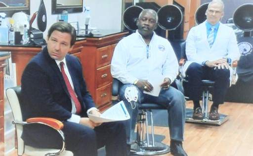 Ron DeSantis meets at a hair salon in Orlando on May 2.