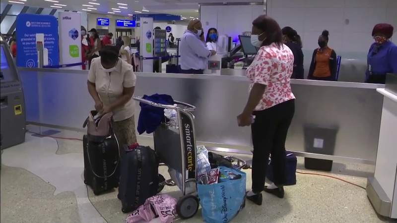 Passengers flying to Haiti with supplies while others arrive at airport after fleeing death, destruction