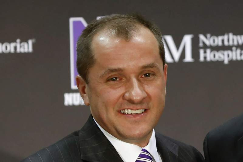 FILE - In this April 2, 2013, file photo, Northwestern University Athletic Director Jim Phillips smiles during a news conference in Evanston, Ill. The Atlantic Coast Conference is finalizing an deal to make Northwestern athletic director Jim Phillips the league's next commissioner. Two people with knowledge of the situation told The Associated Press they expected an agreement to be reached with Phillips and the conference soon. (AP Photo/Charles Rex Arbogast, File)