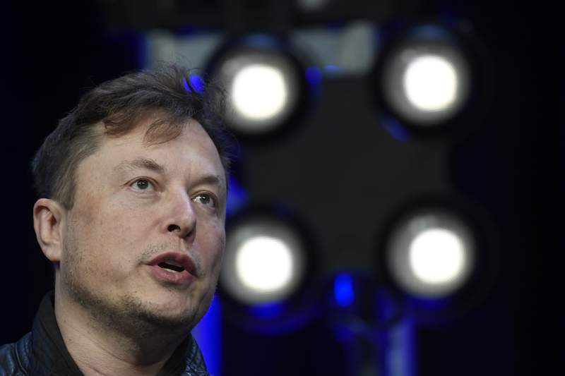 FILE - In this March 9, 2020, file photo, Tesla and SpaceX Chief Executive Officer Elon Musk speaks at the SATELLITE Conference and Exhibition in Washington. Musk has tweeted his way into trouble with another federal agency, this time the National Labor Relations Board. The board on Thursday, March 25, 2021 found that a Musk tweet in May of 2018 unlawfully threatened employees with loss of stock options if they decided to be represented by a union. Board members ordered Tesla to make Musk delete the tweet and stop threatening employees with loss of benefits for supporting a labor organization. (AP Photo/Susan Walsh, File)