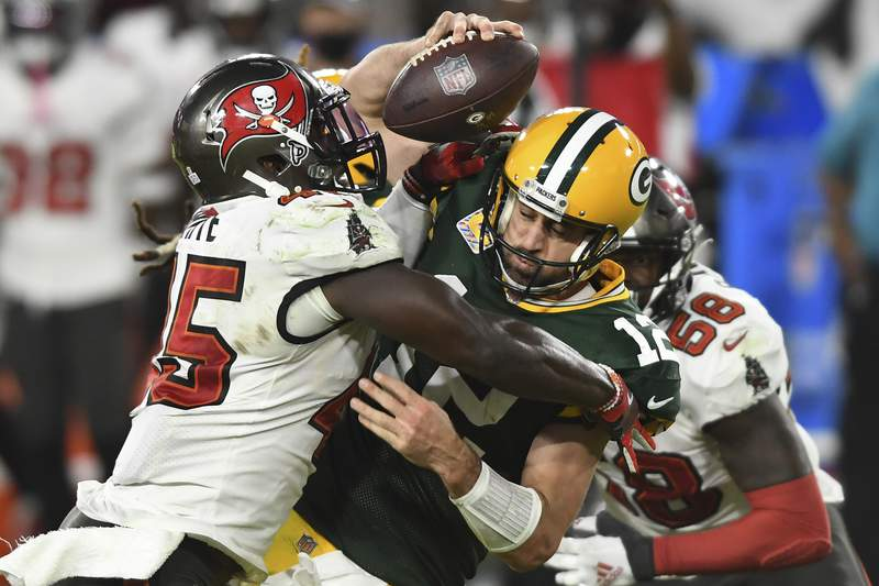 FILE - Tampa Bay Buccaneers inside linebacker Devin White (45) sacks Green Bay Packers quarterback Aaron Rodgers (12) during the second half of an NFL football game in Tampa, Fla., in this Sunday, Oct. 18, 2020, file photo. Rodgers had his worst game of the season in Green Bays 38-10 loss at Tampa Bay Back on Oct. 18, as he threw two game-changing interceptions and completed less than half his pass attempts. Rodgers gets a chance to make amends for that performance Sunday when the top-seeded Packers host the Bucs in the NFC championship game. (AP Photo/Jason Behnken, File)