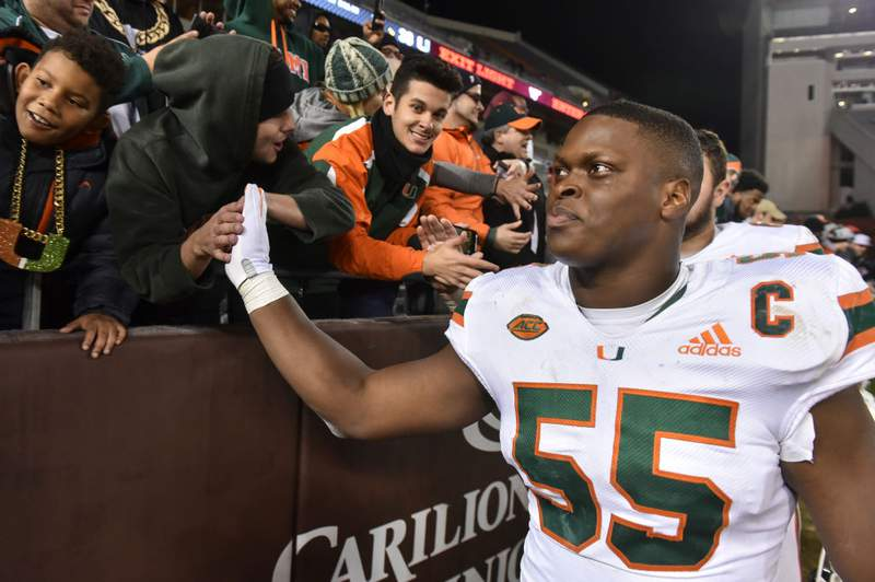 Miami linebacker Shaquille Quarterman high fives fans following a victory over Virginia Tech in 2018. Quarterman, an Oakleaf High grad, is a likely NFL draft pick next week. (Photo by Michael Shroyer/Getty Images)