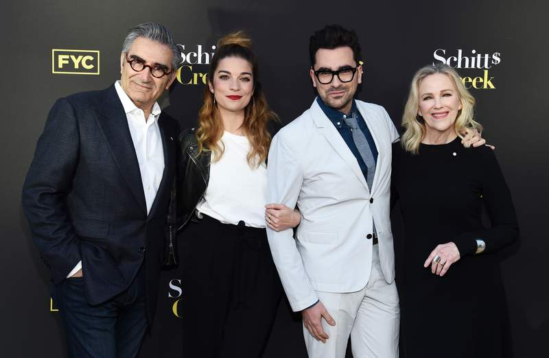 """NORTH HOLLYWOOD, CALIFORNIA - MAY 30: (L-R) Eugene Levy, Annie Murphy, Daniel Levy and Catherine O'Hara arrive at the FYC Screening of Pop TV's """"Schitt's Creek"""" at the Saban Media Center on May 30, 2019 in North Hollywood, California. (Photo by Amanda Edwards/Getty Images)"""