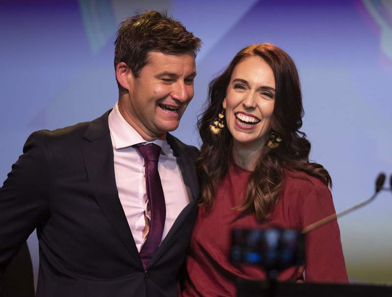 FILE - In this Oct. 17, 2020, file photo, New Zealand Prime Minister Jacinda Ardern, right, is congratulated by her partner Clarke Gayford following her victory speech to Labour Party members at an event in Auckland, New Zealand. Ardern plans to marry her longtime partner during the southern hemisphere summer. The couple announced their engagement two years ago. (AP Photo/Mark Baker, File)