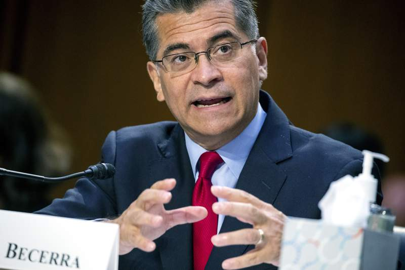 Secretary of Health and Human Services Xavier Becerra testifies at a hearing, Thursday, Sept. 30, 2021, on Capitol Hill in Washington. The Biden administration Thursday finalized long-sought consumer protections against so-called surprise medical bills. The ban on charges that hit insured patients at some of the most vulnerable moments will take effect Jan. 1. (Shawn Thew/Pool via AP)