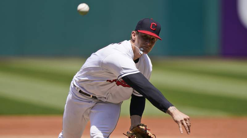 Cleveland Indians starting pitcher Zach Plesac delivers in the first inning of a baseball game against the Minnesota Twins, Sunday, May 23, 2021, in Cleveland. (AP Photo/Tony Dejak)