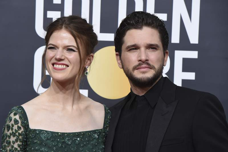 """FILE - Rose Leslie, left, and Kit Harington arrive at the 77th annual Golden Globe Awards on Jan. 5, 2020, in Beverly Hills, Calif. The """"Game of Thrones"""" stars have welcomed a baby boy, their first child together. Harington's publicist Marianna Shafran confirmed the birth Tuesday, Feb. 16, 2021. (Photo by Jordan Strauss/Invision/AP, File)"""